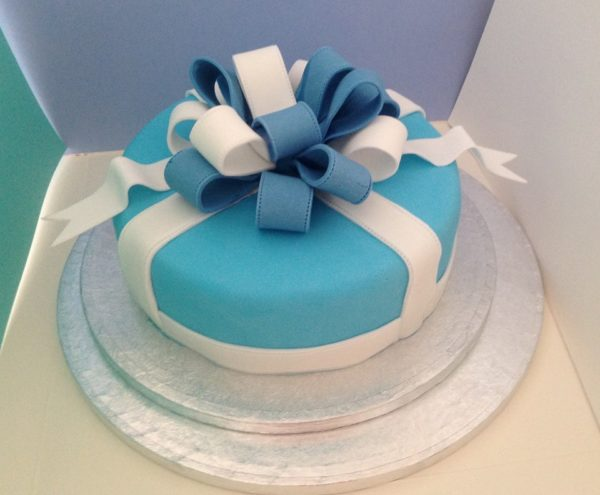 Blue and white bow cake